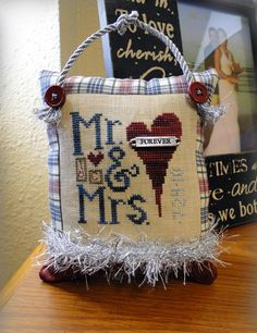 Mr & Mrs ornament, finished out today with plaid/red fabric, and silver trim (bottom one is a knitted icord :)
