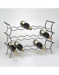 Stackable metal wine rack that holds 6 bottles of wine. The Wine Lounge has a gunmetal finish, displays horizontally and allows stacking for more wine storage. Small Wine Racks, Unique Wine Racks, Free Standing Wine Racks, Wine Rack Cabinet, Wine Auctions, Wine Bottle Rack, Hanging Racks, Wine And Beer, Wine Storage