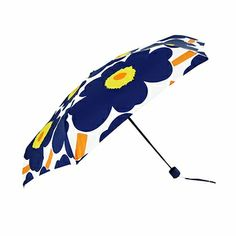 They say great things come in small packages, and this pretty, petite yet practical umbrella is no exception. Marimekko Pieni Unikko Blue/Yellow Mini-Manual Umbrella - $49