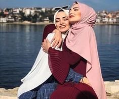 Image may contain: 2 people, people standing, sky, outdoor and water Modern Hijab Fashion, Street Hijab Fashion, Muslim Fashion, Suit Fashion, Hijabi Girl, Girl Hijab, Hijab Outfit, Girl Photo Poses, Girl Photography Poses