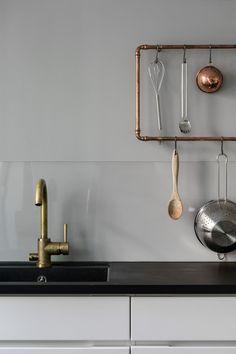 Kitchen with a copper rail - via Coco Lapine Design blog