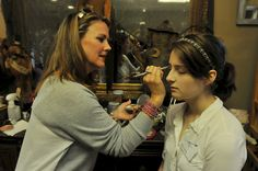 "Geneva, IL Votre Vu Brand Ambassador Heidi Pryor preps French Accents makeup for students before the Geneva High homecoming dance as part of an awareness initiative sponsored by ""A Cutter's Guardian Angel.""  (October 2014)"