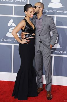 She's a girl on fire; he's a one-man band man. Alicia Keys gets a kiss from her husband Swizz Beatz on the red carpet at the 55th GRAMMY Awards in 2013