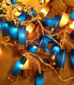 Shot gun shell lights this would be cute around the desert table