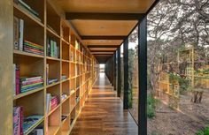 openness of hallway provided by the large glass windows, using hallway as book storage
