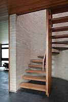 1960s wooden staircase with grey brick wall. | Andy Spain. Photo & Film of the built environment.
