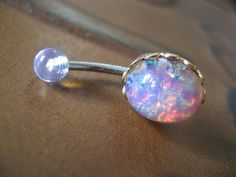 Pink Opal Belly Button Jewelry Stud Ring- Navel Piercing Bar Barbell. $20.00, via Etsy.