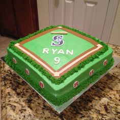 Seattle Mariners baseball vanilla cake.  https://www.facebook.com/sweetnsassycakesbyeva
