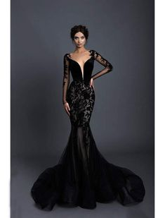Feel fabulous in this theatrical dress from Tarik Ediz 93656. Features an illusion bateau neckline with sheer long sleeves styled with floral appliques extending to the skirt. The velvet fitted bodice is styled with a plunging sweetheart lining and detailed with covered buttons and zipper closure at the back. The skirt flaunts a mermaid silhouette and finishes in a sweep train with horsehair hemline. This Tarik Ediz is perfect for a standout style and flawless fit. Style: tediz_93656 Fabric… Black Mermaid Dress, Mermaid Dresses, Black Lace Gown, Black Fancy Dress, Black Gown With Sleeves, Black Ball Dresses, Black Witch Dress, Red And Black Gown, Black Corset Dress