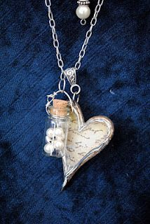 Paper heart and pearl vial