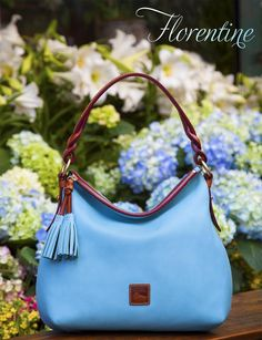 MAY IS FINALLY HERE! To celebrate, we're giving away a Florentine Hobo in the perfect shade of aqua blue.  Enter to win the May Giveaway at  https://www.facebook.com/dooneyandbourke?v=app_194975693850063=1  Take a closer look at the Florentine Twist Strap Hobo at http://www.dooney.com/db/COM05138L540-pin