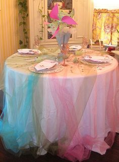so here is what colored tulle over white tablecloth would look like