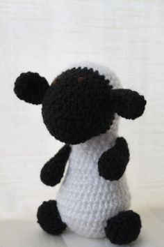 Sid the sheep. Amigurumi plush animal. The animal is approximately 20 cm tall.