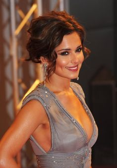 5a2068cb243c British style maven Cheryl Cole tops off her modern red carpet confection  with a middle-parted messy updo. Perfect for gals with curly hair