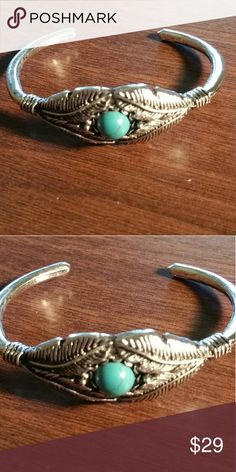 """Silver plated feather bracelet Native American inspired feather bracelet with a 8x6mm oval turquoise.  Inside diameter is 21/4"""". Could be opened slightly but do so very carefully and not very much. Jewelry Bracelets"""