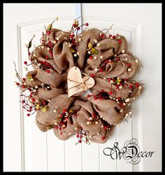 Beautiful burlap with ivory & red berries wreath would look great on your wall or front door.  Wood heart is painted ivory then sanded for an old