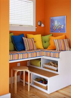 Make the most out of corners and odd spaces in your child's room. This custom storage solution serves several purposes: It's a quiet reading space, a storage powerhouse, and even a desk when the cushion is removed.