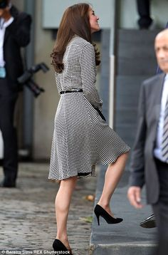 Kate teamed her high-end dress with a pair of her trusty black stilettos, which highlighte...