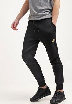 f162d6b1c5 Nike Sportswear Pantalón de deporte - noir doré - Zalando.es Pantalones