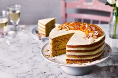 This Mother's Day, try baking an impressive four-layered orange cake sandwiched with creamy almond buttercream. See more Baking recipes at Tesco Real Food. Baking Recipes, Cake Recipes, Baking Ideas, Sweet Recipes, Courgette Cake Recipe, Gin And Tonic Cake, Candied Orange Slices, Sprouting Sweet Potatoes, Orange And Almond Cake