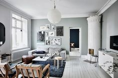 Grey Scandinavian living room with Swedish fireplace
