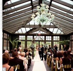 The ceremony was performed in the glass conservatory of the hotel. Amy and Kevin were surrounded by a lush garden and high trees with views of the elegant hotel peeking through on each side. Mahogany chiavari chairs, decorated with citron chair ties, were...