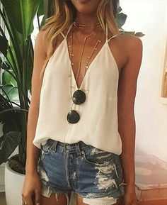 Cream v neck camisole and distressed jean shorts