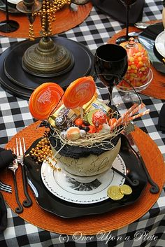 Black Gingham, Ghost Pumpkins, Candy corn, black glassware, Black Toile Charger Plate on top of Orange Placemat (Once Upon a Plate: Halloween Tablescape)