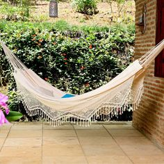XL Brazilian Fabric Hammock with Fringe - Spacious, Cozy EleganceMade from 100% soft, stretchy cotton fabric, this traditional, natural colored Brazilian hammock is cozy enough for one and spa...