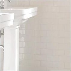 white subway tile.  Timeless.  Inexpensive.  Goes with traditional, contemporary, any style.