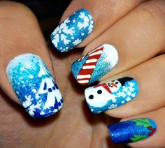 Christmas nail art starring the snowman, a candy cane and mistletoe. A perfect nail art to go with this festive season and very adorable to look at as well.