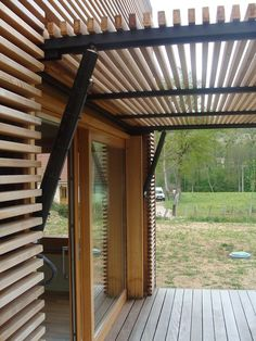 Raw cypress pergola frame dark timber cladding langdons for Menuiserie stand