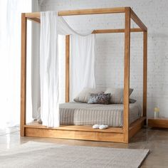 PCH Series Canopy Bed - $4400 through Inmod website. I love this!! Our West Elm nightstands would look great with it also!!