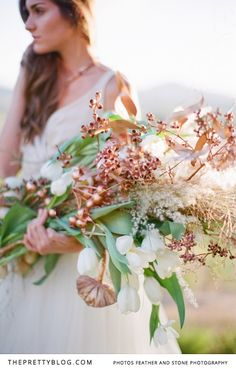 Beautiful winter wedding bouquets, with enchanting coppers and tones of golds! | Photographer: Feather and Stone | Floral Design: Flowers in the Foyer | Champange top: Robyn Roberts Bridal Wear | Champange Lace Dress, Tulle Skirt : Gelieft | Copper Accessories: Jewellery by Anna Raimondo