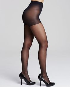 Crafted with graduated compression for improved circulation, these Calvin Klein Hosiery tights flaunt a classic sheer finish while slimming your silhouette. Style #904F | Nylon/spandex | Hand wash | M