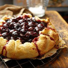 Sour Cherry-Sour Cream Crostata Pie Recipe Desserts with all-purpose flour, cornmeal, brown sugar, unsalted butter, cold water, kosher salt, sour cream, sour cherries, sugar, corn starch, lemon zest