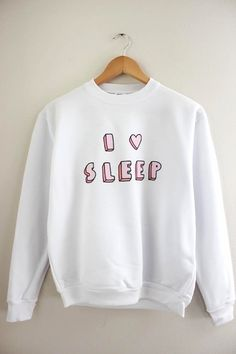 I Love Sleep pink graphic design on a soft, white, 100% polyester crewneck sweatshirt. This sweatshirt is made using a commercial heat sublimation process for the highest quality possible.