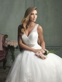 We love sweetheart necklines with sheer overlays –so elegant. As seen as Allure Bridals