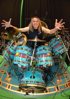 Nicko McBrain -   colorful turquoise blue decorated drumkit shells.