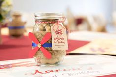 Mason jar treats at a vintage airplanes first birthday party! See more party planning ideas at CatchMyParty.com!