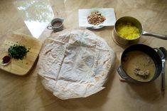 All cooked ingredients ready to assemble Jordanian Mansaf - lamb, yogurt and rice pilaf
