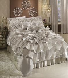 """Dazzling…dramatic…and blooming with unabashed romance, this shimmering bedding in pale taupe will make you (or your guests!) feel like glamorous, Hollywood Royalty. Each sold separately.  Bedding: This exquisite comforter ripples outward in six layers of satin ruffle """"petals"""" with a stunning, rhinestone jewel center. Coordinating shams, accent pillows and window treatments sold separately. Polyester with polyester fill; spot clean or dry clean. Imported."""