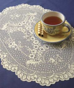 Floret is a delicate antique lace placemat pattern with matching curtains available.  Set of 4 $23.95.