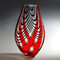 clear with red stripes & black swirls