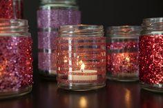 Easy DIY Glittered Glass Jars by Martha Stewart.  Easy to make a striped glitter pattern too.