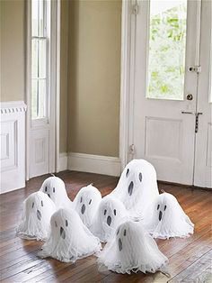 Tissue Paper Ghosts:  Glue eyes and mouth to White tissue-paper wedding bells. Then drape Cheesecloth over them.