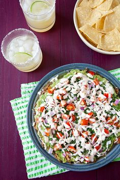 Modernized Mexican Seven Layer Dip | While many of the components could be made in advance' it is best to make the guacamole fresh and assemble the dip not too long before you plan to serve it. #Homemaderecipes