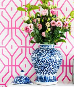 pink wallpaper with blue/white ginger jar