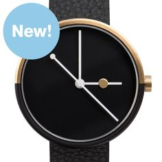 Eclipse (black/gold) watch by AÃRK. Available at Dezeen Watch Store: www.dezeenwatchstore.com