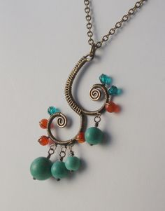 Wire Wrapped Indian Ehtnic Style Pendant, Antiqued Brass, Turquoise and Orange. $39.00, via Etsy.